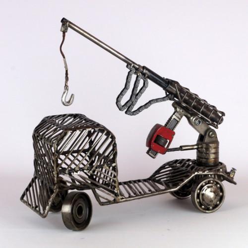 car metal sculpture crane crane