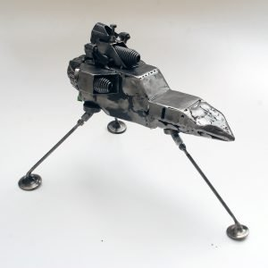 sci fi art sculpture made of scrap metal parts