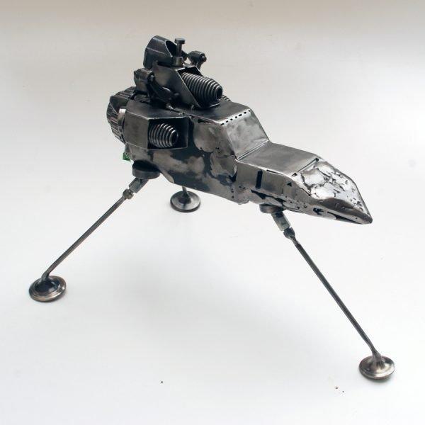 sci fi art sculpture made of scrap metal parts