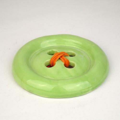 Green ceramic button by Despoina Xenaki