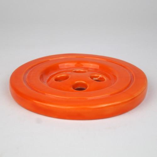 Orange ceramic button by Despoina Xenaki