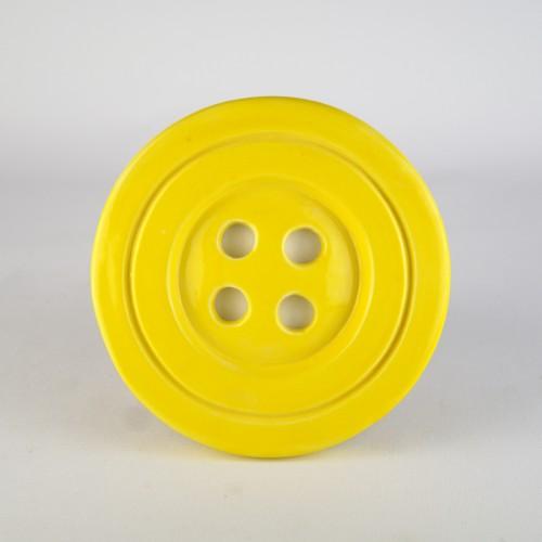 Yellow ceramic button by Despoina Xenaki