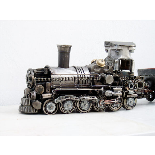 Train artwork made of scrap metal parts